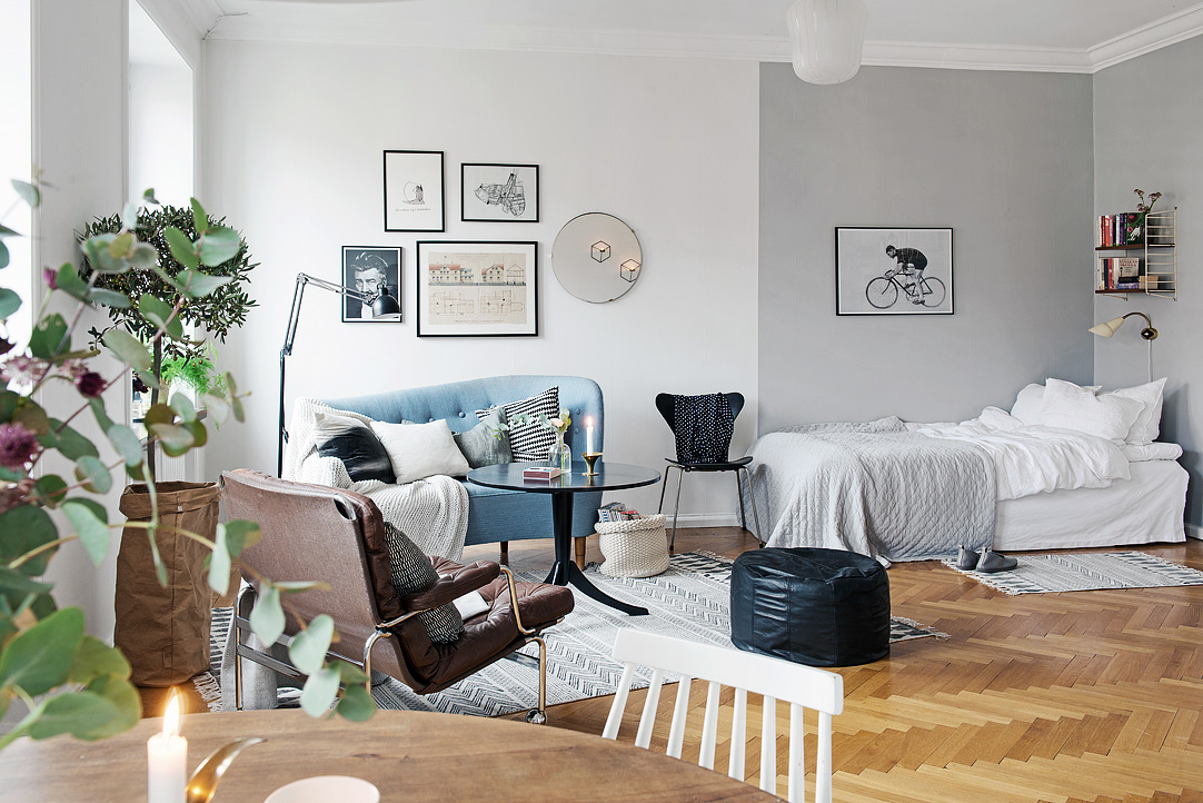 how to decorate a large living room with little furniture tall corner units for stylish swedish studio apartment lives