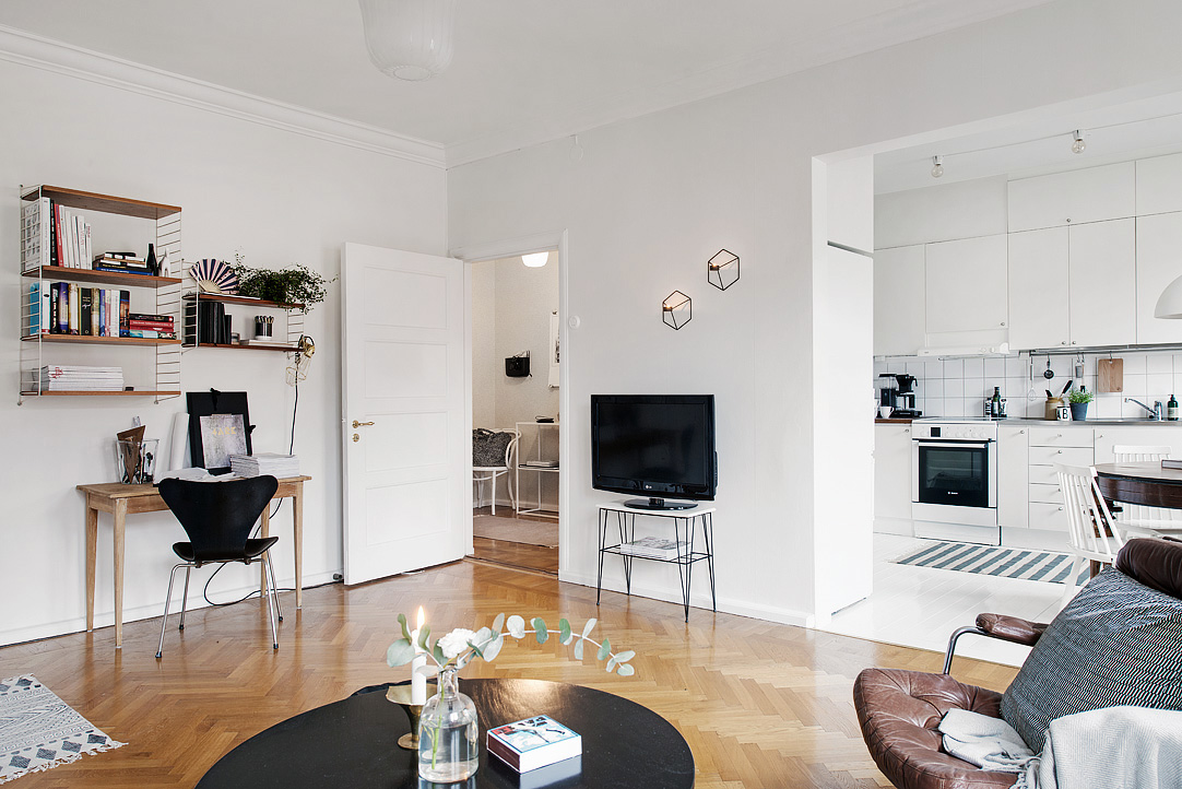 desk in living room apartment candice olson stylish swedish studio lives large collect this idea 7 1