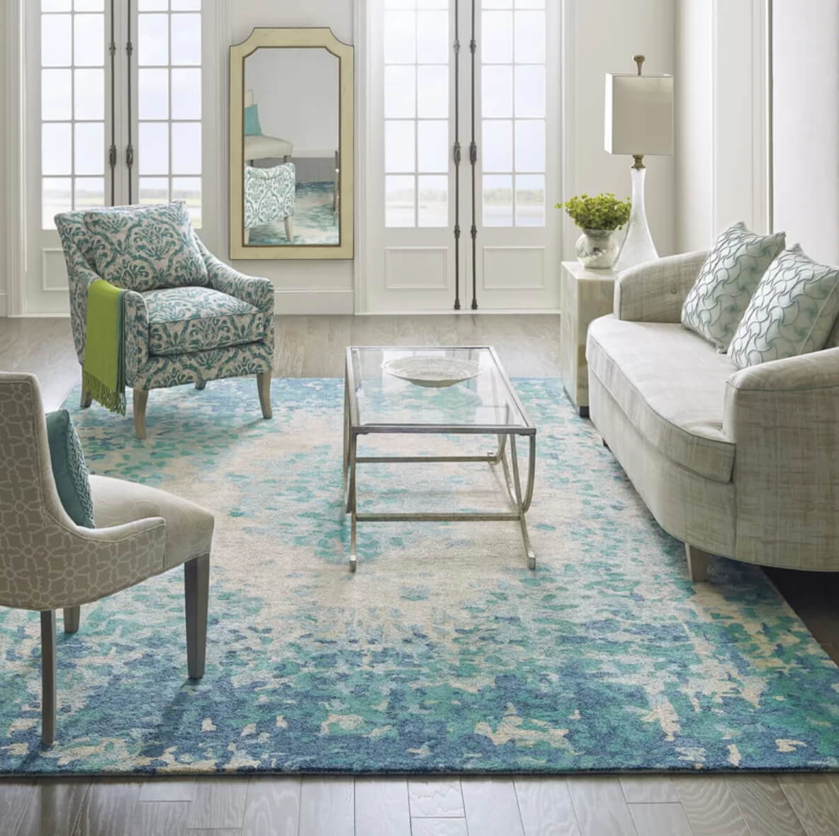 rugs in living room how to design curtains for 12 rug ideas that will change everything the looking glass adds romance a with an impressionistic floral pattern image perigold