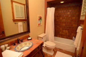 Bathroom With Terracotta Floor Tiles