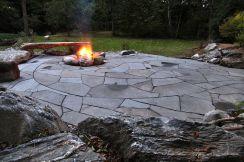 Backyard Patio With Stone Firepit 15