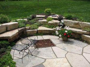 Backyard Patio With Stone Firepit 17