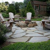 Backyard Patio With Stone Firepit 25