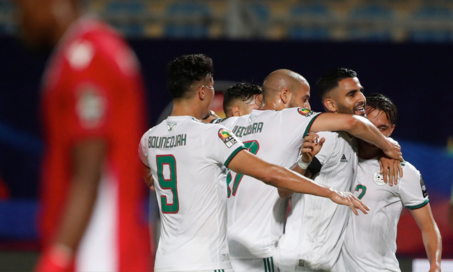 Players of Algerian national team celebrate their victory over Kenya