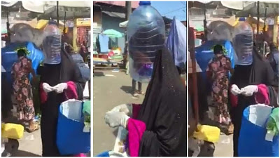VIDEO: Hilarious! Woman Covers Her Head With Empty Container To Avoid Coronavirus