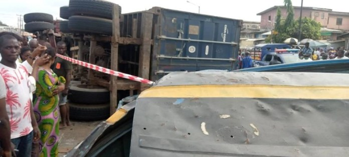 Container Fells On Commercials Bus Kill Two In Lagos (Photos)