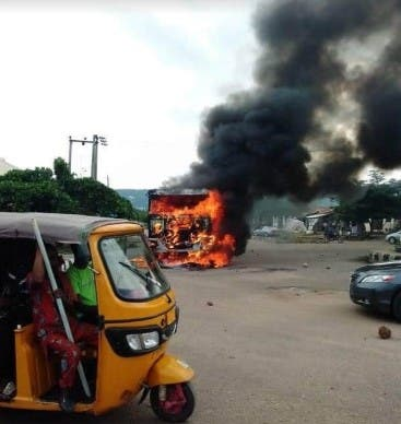Irate Youth Set Two Armed Robbers Ablaze In Ibadan (Photos)