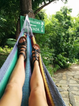 Relaxing in a handcrafted hammock beside Laguna de Apoyo