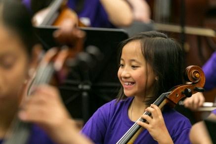 Young girl plays cello