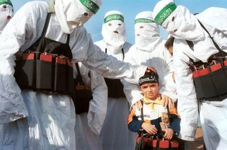 Hamas members with young recruit
