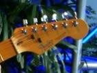 pd-playing-guitar-headstock-crop