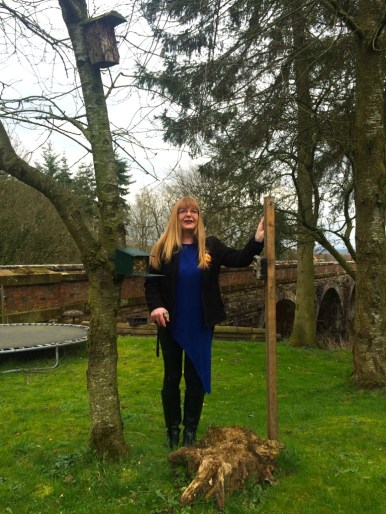 Julie with her red squirrel feeders