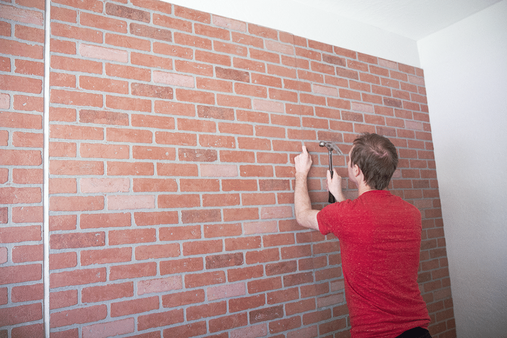 Faux brick wall panel installation