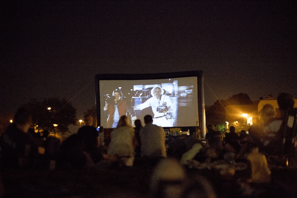 Perfect Creative Summer Date Idea: Head to the Street Food Cinema and grab amazing street food and enjoy a classic movie outdoors