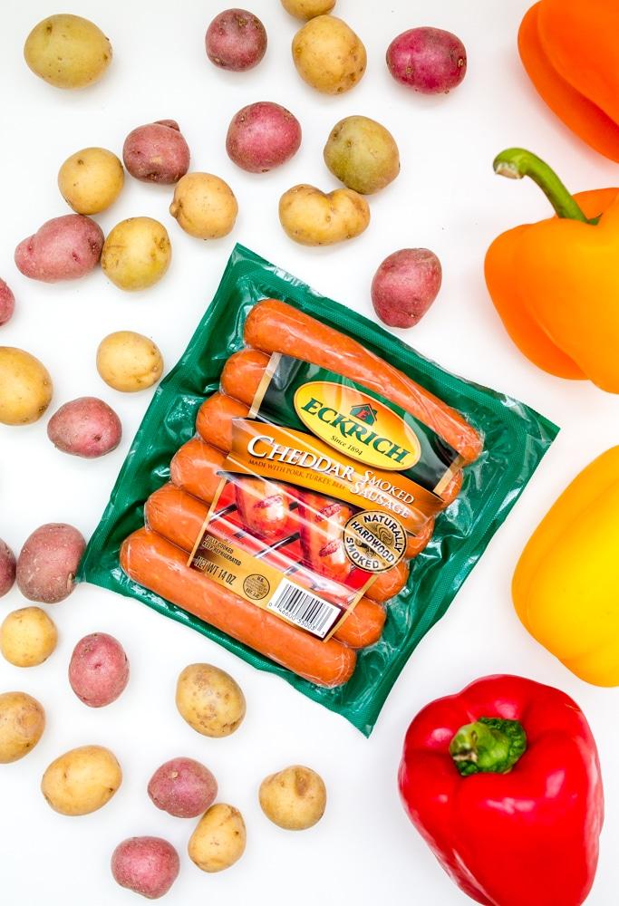 Potato pepper and sausage sheet pan dinner ingredients