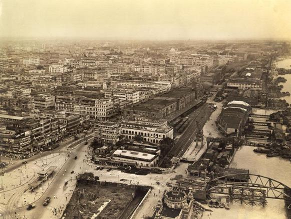 Aerial view of Calcutta downtown. In upper left background is Hindusthan building, U.S. Army HQ. The oldest part of the city starts at the esplanade and extends upwards. The city was founded in the early 1700's.
