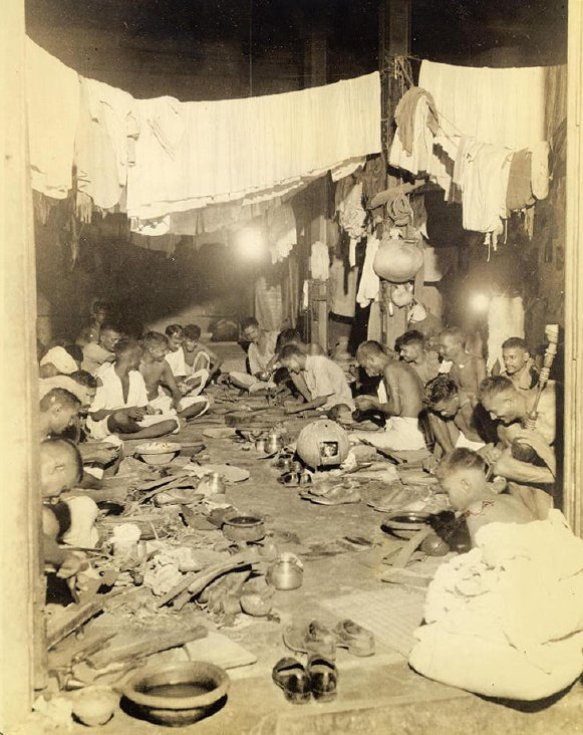 Down one alley you might see a shop such as this one, packed with shoemakers sewing and cutting orpulling on a hookah such as the one at right. Combined with the shoemaking enterprise is a laundry (dhobie). During monsoon, dhobie must contrive to dry clothes inside, tho hampered by shortage of sheltered spaces.