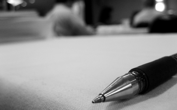 Pen_on_table___Flickr_-_Photo_Sharing_