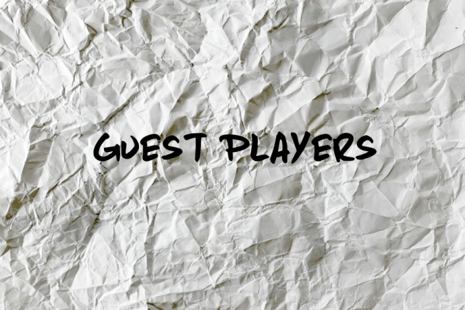 """A piece of paper that has been crumpled up and smoothed back out several times. Black text over the image reads, """"Guest Players"""""""