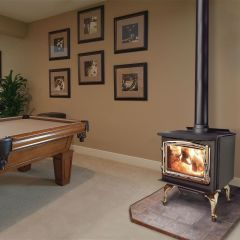 Enviro Kodiak Wood Stove with gold doors and gold legs.