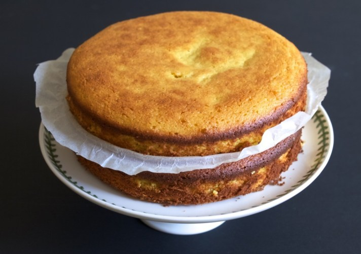 Orange and white chocolate cake with raspberries