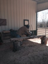 Eric using the saw mill to rough cut the planks
