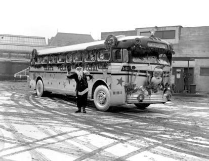 """""""Vancouver Island Coach Lines Christmas Bus; Crystal Gardens In The Background."""" [1951]. Image I-02458/RBCM&A"""