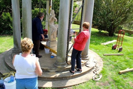 Nancy Fahy and Patsy Thompson photograph Pan's installation