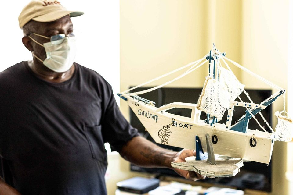 Charleston artist, William Washington, displays his shrimp boat art made from popsicle sticks