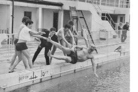 circa 1970's Lifeguard Walter Cornelius getting tossed into the pool.