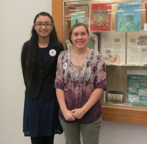 Shaheen Hasan and Emily Aucompaugh greet patrons
