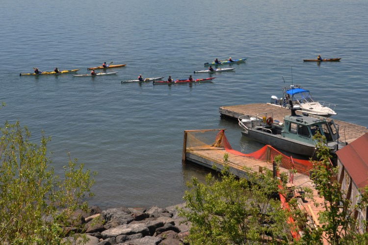Kayakers paddle by the pier in this file photo