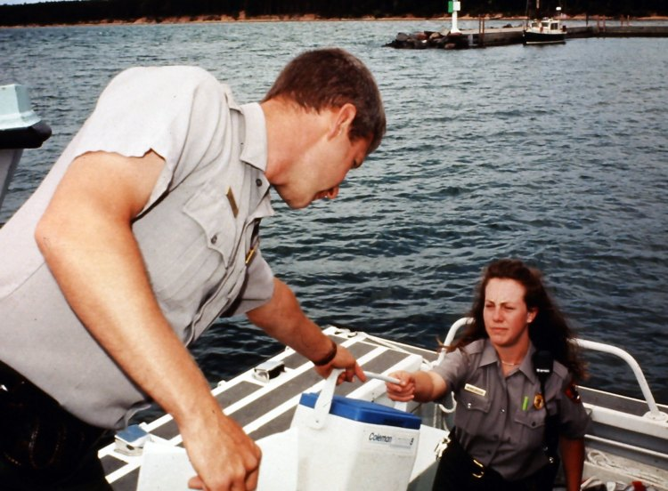Rangers Jeff Field and Wendy Bredow unloading a boat at Stockton Island