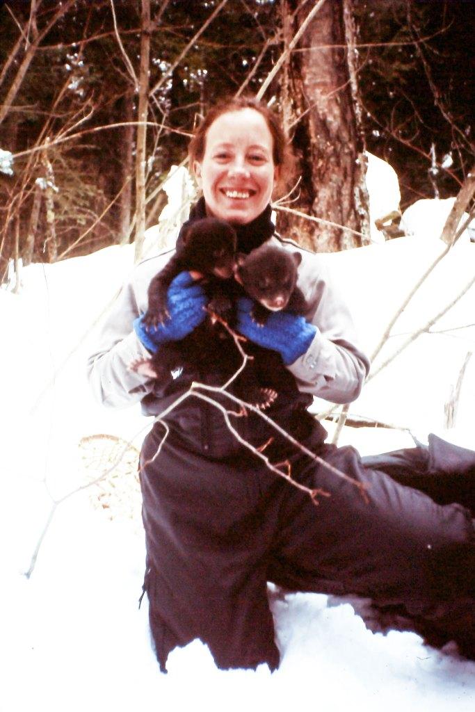 Wendy Bredow with a bear cub on Stockton Island