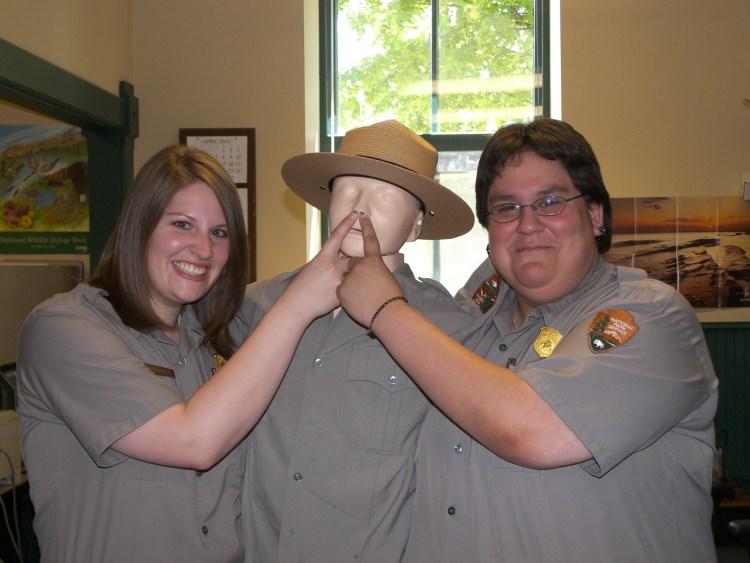 Elise and Katrina Werchouski shush a dummy ranger in the Bayfield office