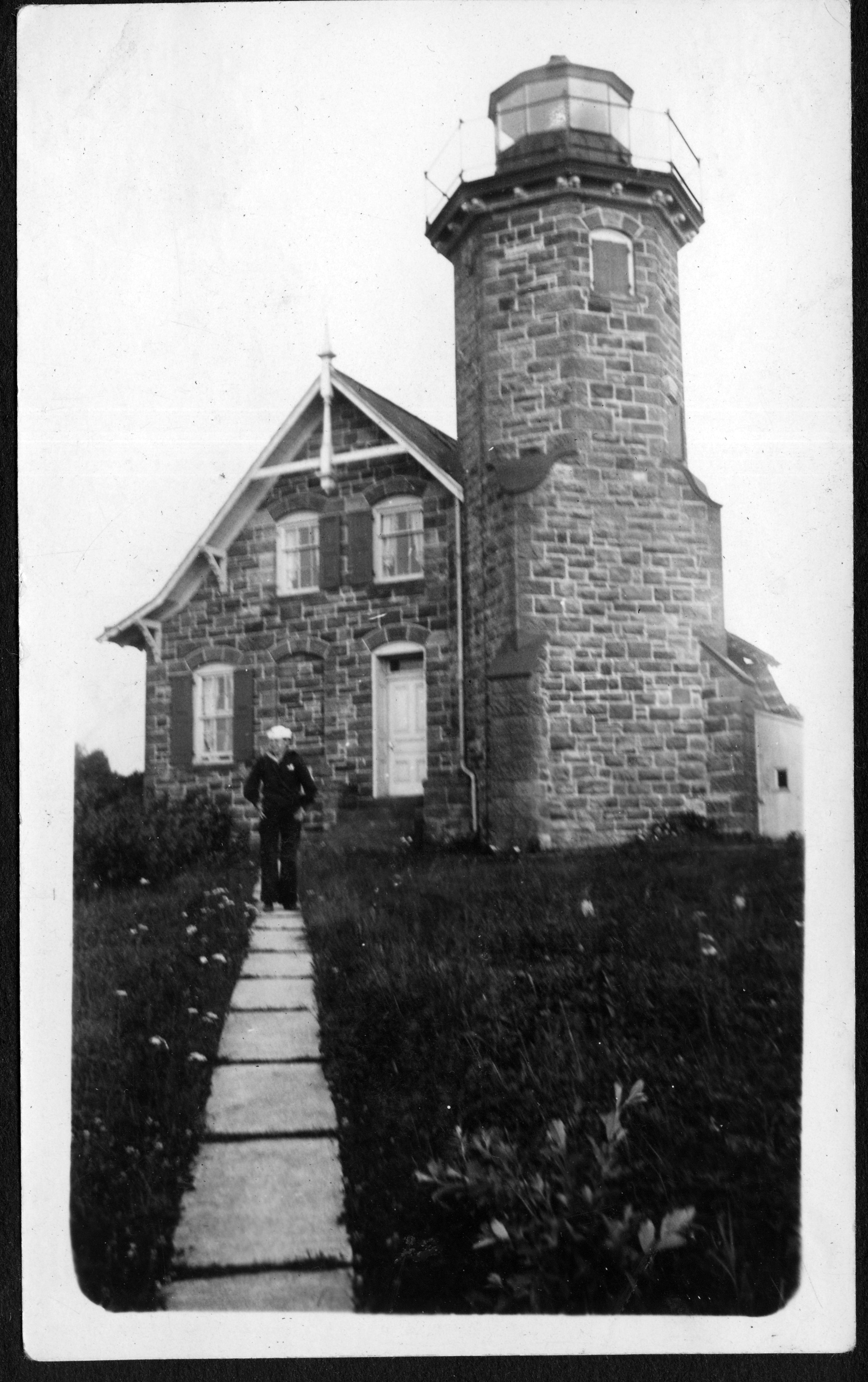 Gert standing in front of the Sand Island light