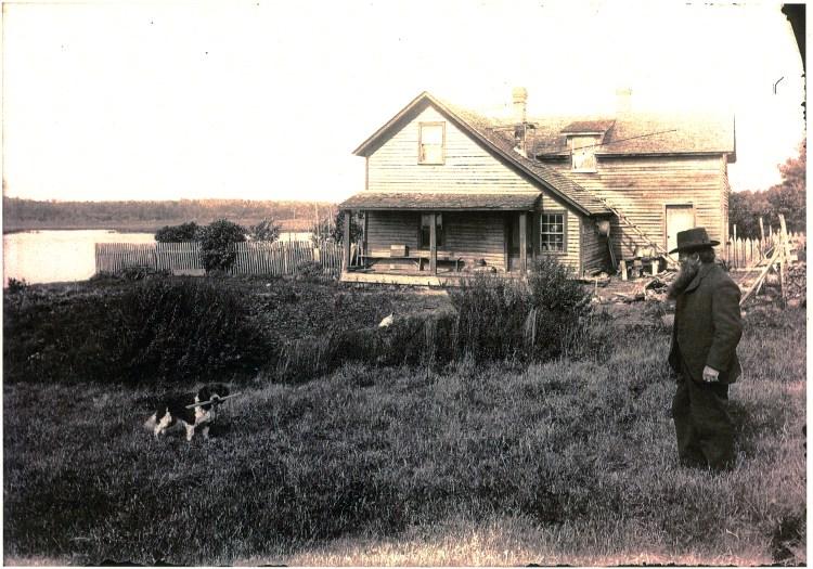 Francis Jacker at his farm near Portage Entry, Michigan