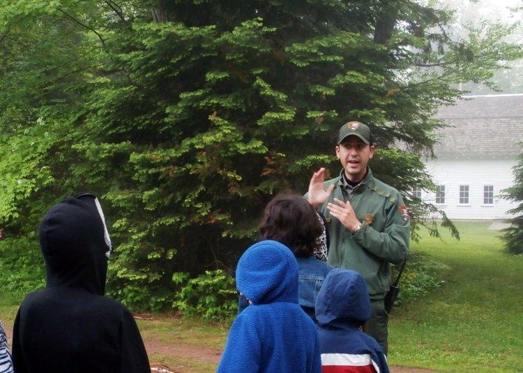 Josh talks to a school group at the Hokenson Fishery