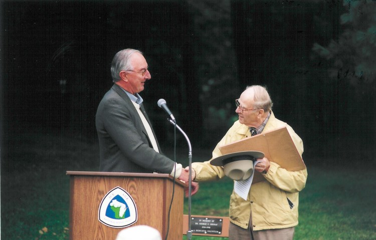 NPS Midwest Regional Director William Schenk makes Gaylord Nelson an honorary park ranger in 2002