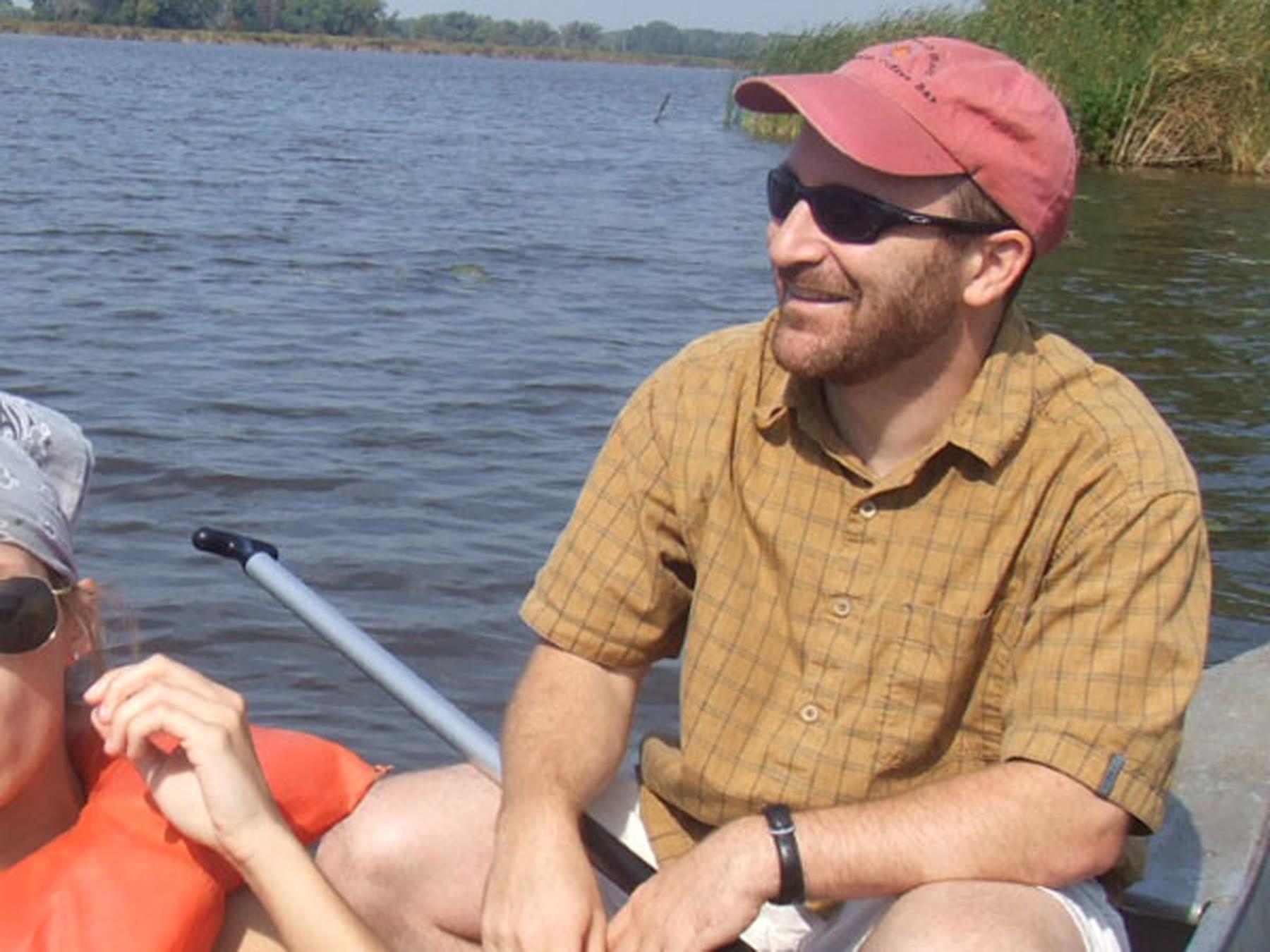 Jim Feldman paddling a canoe