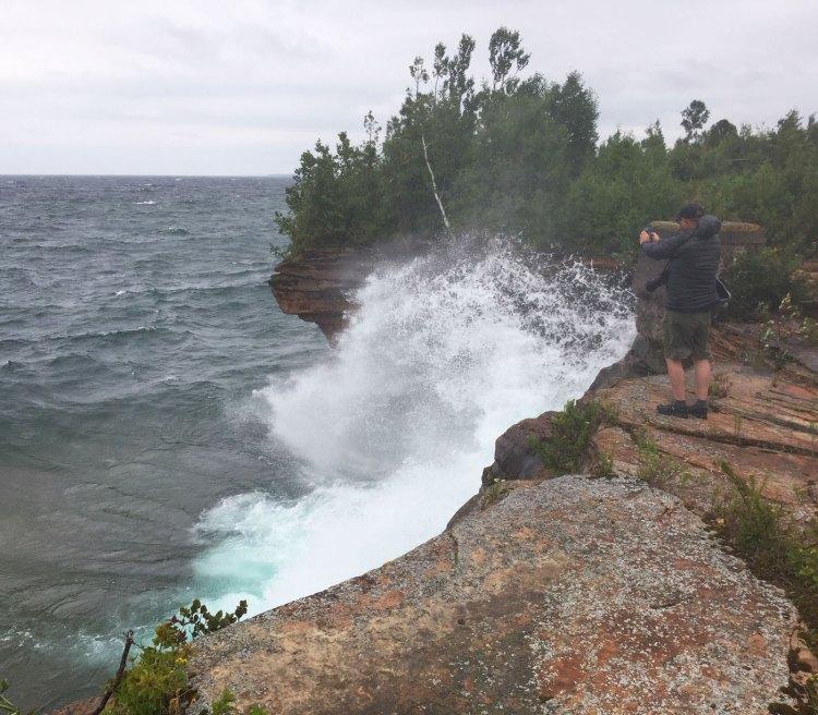 Waves crashing into the Devils Island cliffs
