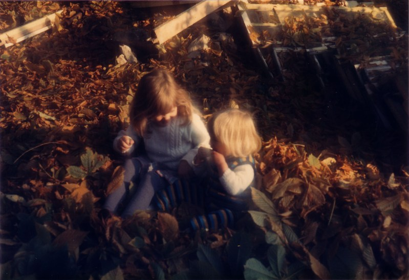 Ah, me and my big sis. Wait...is she feeding me leaves??