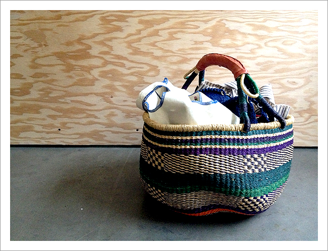 african basket full of knitting projects