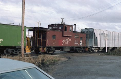 Caboose 11547 (Frisco 1219) at Thayer, Missouri on March 5, 1983 (R.R. Taylor)