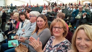 Happy choir members enjoying a fabulous day out at the Llangollen Eisteddfod .