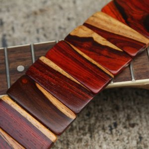Handmade Wooden Guitar Straps and Picks by Revo
