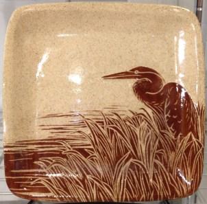 Stoneware plate, sgraffito carved heron design