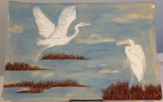 Stoneware platter, sgraffito carved egrets designs
