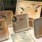 Booth display, hummingbird-themed tableware