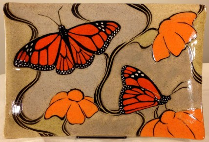 Stoneware platter, sgraffito carved monarch butterflies motif